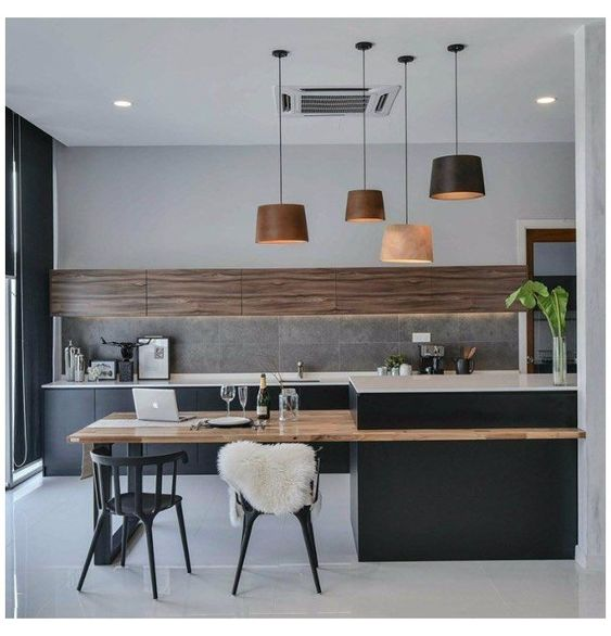 Kitchen with Island extended breakfast Bar, pendant lights